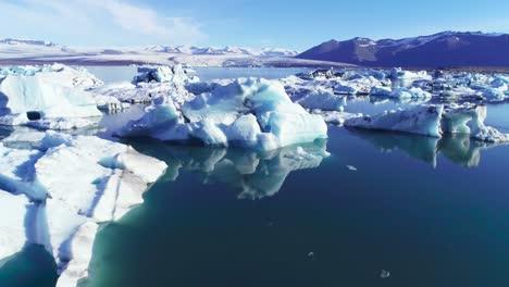 Beautiful-aerial-over-icebergs-in-the-Arctic-Jokulsarlon-glacier-lagoon-in-Iceland-10