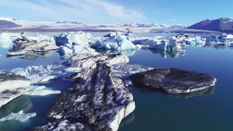 Beautiful-aerial-over-icebergs-in-the-Arctic-Jokulsarlon-glacier-lagoon-in-Iceland-11