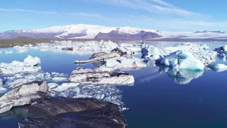 Beautiful-aerial-over-icebergs-in-the-Arctic-Jokulsarlon-glacier-lagoon-in-Iceland-13