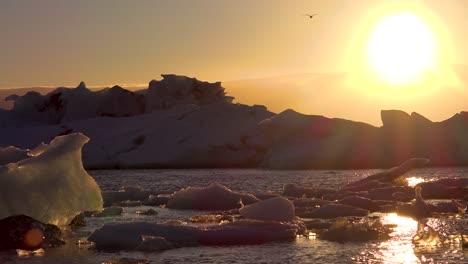Midnight-sun-sets-in-the-frozen-Arctic-Jokulsarlon-glacier-lagoon-in-Iceland-suggesting-global-warming