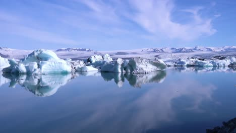 Icebergs-and-cloud-formations-in-the-frozen-Arctic-Jokulsarlon-glacier-lagoon-in-Iceland-suggesting-global-warming