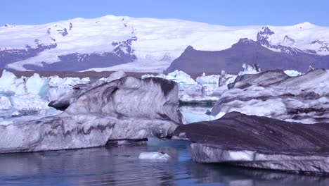 Icebergs-and-cloud-formations-in-the-frozen-Arctic-Jokulsarlon-glacier-lagoon-in-Iceland-suggesting-global-warming-1