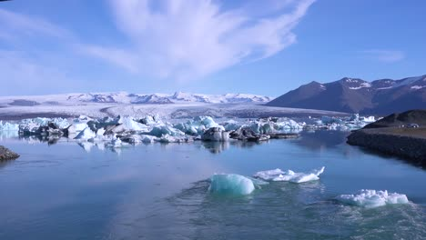 Icebergs-in-a-river-in-the-frozen-Arctic-Jokulsarlon-glacier-lagoon-in-Iceland-suggesting-global-warming