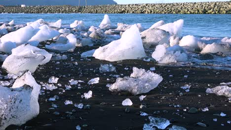 Icebergs-sit-on-black-sand-Diamond-Beach-Jokulsarlon-in-the-Arctic-Iceland-polished-and-glistening-like-jewels-1