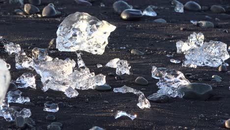 Icebergs-sit-on-black-sand-Diamond-Beach-Jokulsarlon-in-the-Arctic-Iceland-polished-and-glistening-like-jewels-2