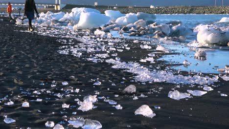Icebergs-sit-on-black-sand-Diamond-Beach-Jokulsarlon-in-the-Arctic-Iceland-polished-and-glistening-like-jewels-5