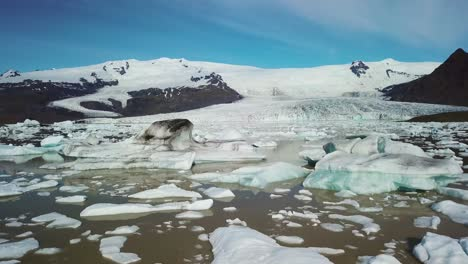 Slow-aerial-across-the-massive-glacier-lagoon-filled-with-icebergs-at-Fjallsarlon-Iceland-suggests-global-warming-and-climate-change-9