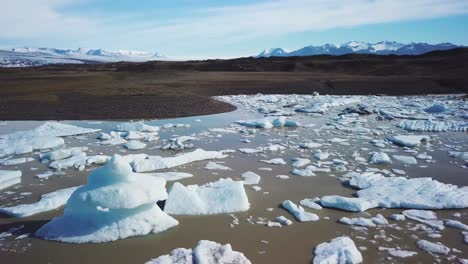 Slow-aerial-across-the-massive-glacier-lagoon-filled-with-icebergs-at-Fjallsarlon-Iceland-suggests-global-warming-and-climate-change-14