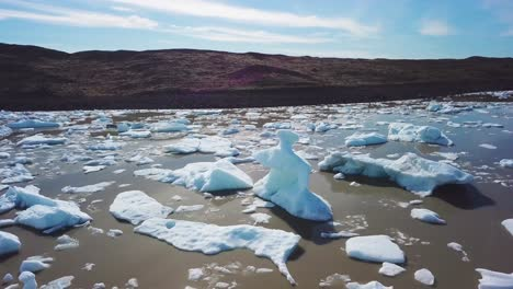 Slow-aerial-across-the-massive-glacier-lagoon-filled-with-icebergs-at-Fjallsarlon-Iceland-suggests-global-warming-and-climate-change-15