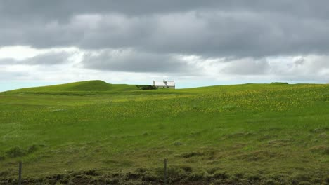 A-lonely-and-remote-house-in-the-wild-green-countryside-of-Iceland