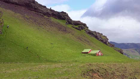 A-lonely-and-remote-farmhouse-in-the-wild-green-countryside-of-Iceland