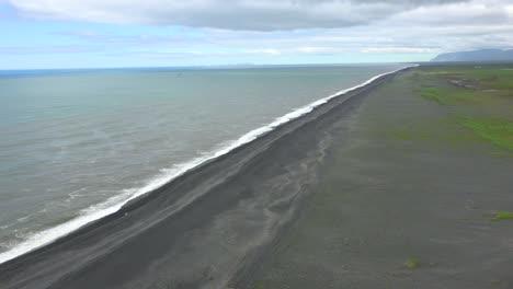 Establishing-shot-of-Dyrh_____-laey-black-sand-beach-Iceland