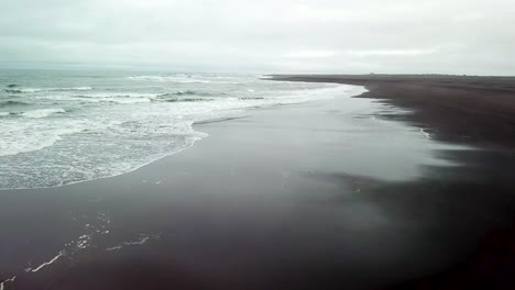 Haunting-beautiful-aerial-over-a-black-sand-beach-in-Southern-Iceland-3