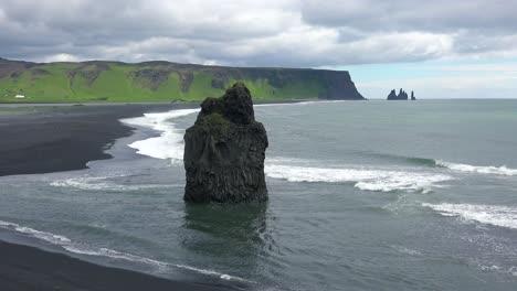 Beautiful-rock-formation-at-Dyrh_____'laey-black-sand-beach-Iceland