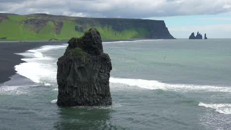 Beautiful-rock-formation-at-Dyrh_____'laey-black-sand-beach-Iceland-1