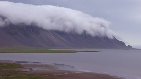 Amazing-time-lapse-shot-of-remarkable-beautiful-fjords-in-Iceland-with-clouds-and-fog-rolling-over-the-top