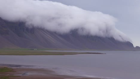 Amazing-time-lapse-shot-of-remarkable-beautiful-fjords-in-Iceland-with-clouds-and-fog-rolling-over-the-top-1