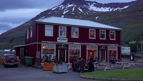 Diners-eat-and-drink-at-a-local-pub-in-Seydisfjordur-Iceland