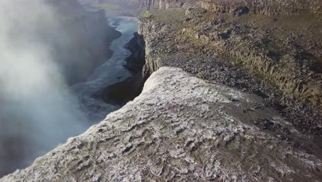 Aerial-over-Dettifoss-Iceland-one-of-the-most-remarkable-waterfalls-in-the-world-with-rainbow