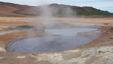 A-bubbling-mud-pool-in-a-geothermal-area-along-a-road-near-Myvatn-Iceland