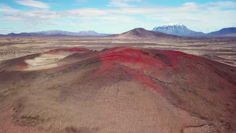 Spectacular-aerial-over-red-ash-topped-volcanoes-and-lava-flows-in-the-remote-highland-interior-of-Iceland-1