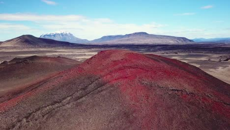 Spectacular-aerial-over-red-ash-topped-volcanoes-and-lava-flows-in-the-remote-highland-interior-of-Iceland-3