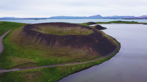 Beautiful-aerial-over-hikers-exploring-volcanic-cones-in-Lake-Myvatn-Iceland