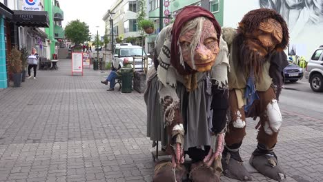 Two-giant-troll-figures-stand-on-the-streets-of-Akureyri-Iceland