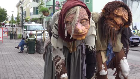 Two-giant-troll-figures-stand-on-the-streets-of-Akureyri-Iceland-1