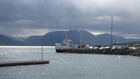 A-fishing-boat-is-docked-in-a-harbor-in-Iceland