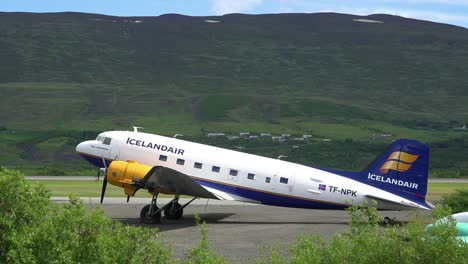 An-Icelandair-DC-3-prop-plane-sits-on-a-runway-at-an-airport
