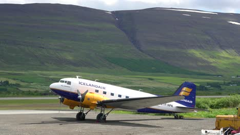 An-Icelandair-DC-3-prop-plane-sits-on-a-runway-at-an-airport-1