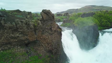 Aerial-over-the-Hjalparfoss-waterfall-in-Iceland