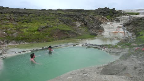 Tourists-bathe-in-the-Hveravellir-hot-springs-natural-geothermal-baths-in-the-highlands-of-central-Iceland