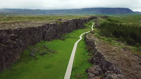 Beautiful-aerial-of-the-mid-Atlantic-ridge-running-through-Thingvellir-Iceland-6