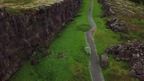 Beautiful-aerial-of-the-mid-Atlantic-ridge-running-through-Thingvellir-Iceland-7