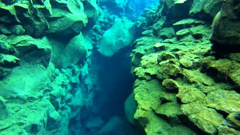 Underwater-diving-snorkeling-footage-following-the-mid-Atlantic-ridge-fissure-in-Thingvellir-Iceland