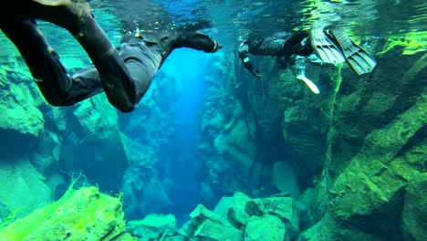 Underwater-diving-snorkeling-footage-following-the-mid-Atlantic-ridge-fissure-in-Thingvellir-Iceland-2