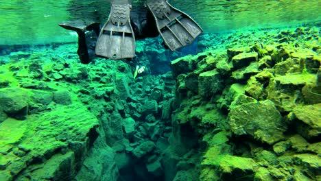 Underwater-diving-snorkeling-footage-following-the-mid-Atlantic-ridge-fissure-in-Thingvellir-Iceland-4