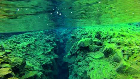 Underwater-diving-snorkeling-footage-following-the-mid-Atlantic-ridge-fissure-in-Thingvellir-Iceland-5