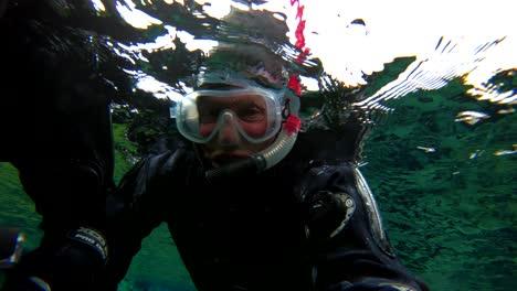 Underwater-diving-snorkeling-footage-following-the-mid-Atlantic-ridge-fissure-in-Thingvellir-Iceland-6