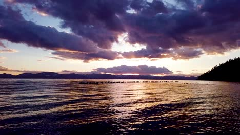 A-beautiful-aerial-over-Lake-Tahoe-Nevada-pier-pilings-in-water-at-sunset-or-sunrise