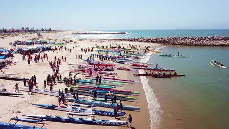 Aerial-over-outrigger-canoes-on-a-beach-during-a-rowing-race-on-the-Pacific-ocean-near-Ventura-California
