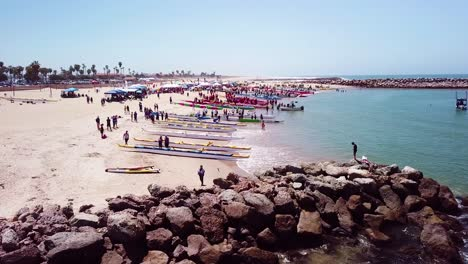 Aerial-over-outrigger-canoes-on-a-beach-during-a-rowing-race-on-the-Pacific-ocean-near-Ventura-California-1