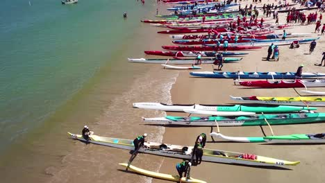 Aerial-over-outrigger-canoes-on-a-beach-during-a-rowing-race-on-the-Pacific-ocean-near-Ventura-California-2
