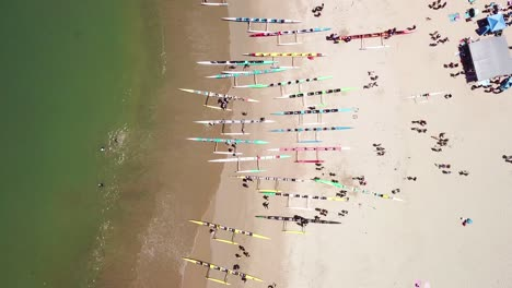 Aerial-over-outrigger-canoes-on-a-beach-during-a-rowing-race-on-the-Pacific-ocean-near-Ventura-California-4