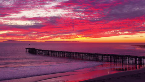 An-astonishing-sunset-aerial-shot-over-a-long-pier-and-the-Pacific-Ocean-and-Channel-Islands-in-Ventura-Southern-California-3