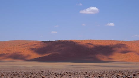Time-lapse-of-clouds-moving-over-the-barren-grasslands-and-sand-dunes-of-Namibia