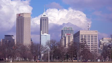 Unusual-time-lapse-of-Indianapolis-Indiana-with-traffic-moving-normally-in-lower-half-and-downtown-city-skyline-and-clouds-in-timelapse-above