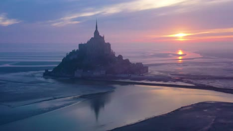 Moody-aerial-of-Mont-Saint-Michel-France-silhouetted-at-sunrise-in-fog-1